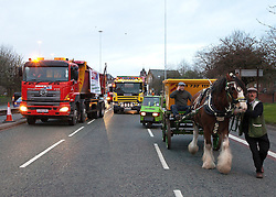 "© under license to London News Pictures. 1/4/2010: Fuel protest organiser Tony Cauchi (sitting on cart), who runs local business Salford Skip Hire. A skip company owner caused tailbacks in Manchester this morning (Fri) by deciding to move one of his skip's by horse and cart. Mr Cauchi organised this morning's fuel protest, along with several other local business, over the last four months. He says the 1p reduction in fuel tax is ""no help"" and calls for a 10 pence reduction on the price of fuel. Credit should read ""Joel Goodman/LNP""."