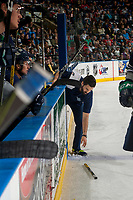 KELOWNA, CANADA - APRIL 25: Seattle Thunderbirds' athletic therapist Phil Varney picks up a broken stick off the ice at the Kelowna Rockets on April 25, 2017 at Prospera Place in Kelowna, British Columbia, Canada.  (Photo by Marissa Baecker/Shoot the Breeze)  *** Local Caption ***