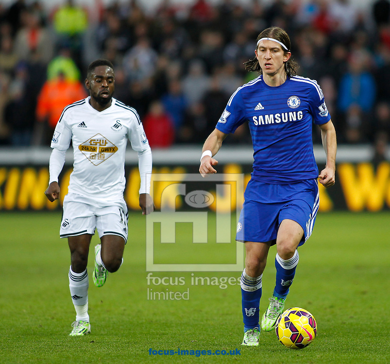 Nathan Dyer of Swansea City and Filipe Luis of Chelsea during the Barclays Premier League match at the Liberty Stadium, Swansea<br /> Picture by Mike Griffiths/Focus Images Ltd +44 7766 223933<br /> 17/01/2015