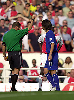 Photo: Richard Lane.<br />Arsenal v Everton. Barclaycard Premiership.<br />16/08/2003.<br />Li Tie is sent off by Mike Halsey for his second booking.