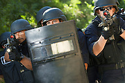 Swat officers with gun and shield