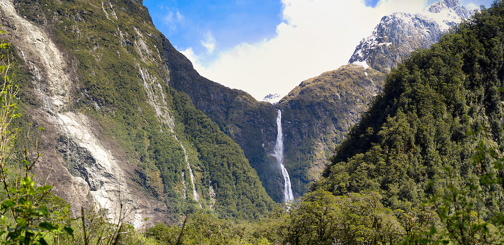 Panoramic view of Sutherland Falls from across the Arthur River, along the Milford Track, Fiordland National Park, New Zealand