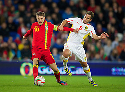 11.10.2013, City Stadion, Cardiff, WAL, FIFA WM Qualifikation, Wales vs Mazedonien, Gruppe A, im Bild Wales' Aaron Ramsey in action against Macedonia's Muhamed Demiri during the FIFA World Cup Qualifier Group A Match between Wales and Macedonia at the City Stadium, Cardiff, Wales on 2013/10/11. EXPA Pictures © 2013, PhotoCredit: EXPA/ Propagandaphoto/ David Rawcliffe<br /> <br /> ***** ATTENTION - OUT OF ENG, GBR, UK *****