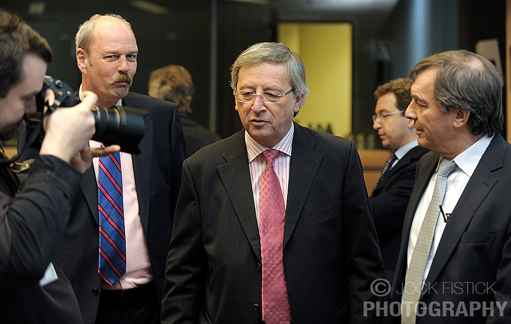 Jean-Claude Juncker, Luxembourg's prime minister, center and Jeannot Krecke, Luxembourg's minister of economy and foreign trade, right, arrive for Euro Group, the monthly meeting of economic and finance ministers from EU countries that use the Euro, on Monday, March 9, 2009, in Brussels, Belgium. (Photo © Jock Fistick)