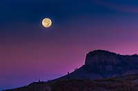 Sunrise, moonset over tne Curecanti National Rcreation Area.  Colorado.