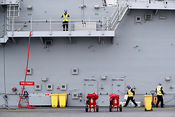 Final preparations are made by engineers and crew on the flight deck ahead of sea trials this summer, for the Royal Navy's new aircraft carrier HMS Queen Elizabeth, at Rosyth Dockyard in Dunfermline.