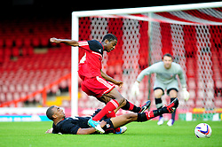Brentford's U21s Leon Legge tackles Bristol City U21's Kevin Karns as he was preparing to shoot - Photo mandatory by-line: Dougie Allward/Josephmeredith.com  - Tel: Mobile:07966 386802 04/09/2012 - SPORT - FOOTBALL - Professional Development League -  Bristol  - Ashton Gate -  Bristol City U21s v Brentford U21s