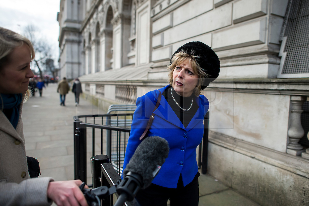 © Licensed to London News Pictures. 20/02/2016. London, UK. ANNA SOUBRY MP being questioned by SKY Television as she arrives at downing street for a cabinet meeting the day after David Cameron finalised negotiations over Britain's membership of the EU. Photo credit: Ben Cawthra/LNP