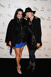 Left to right, KIRAN SHARMA and ANNA WINSLET sister of Kate Winslet at a party to celebrate the 1st birthday of nightclub 2&8 at Mortons held in Berkeley Square, London on 3rd October 2013.