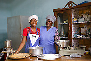Joyce Marwa (right) in the kitchen with one of her employees.<br /> <br /> Joyce set up and now runs a bakery that bakes bread and cakes. She also processes nutritious flour (a mix of 5 grains)<br /> <br /> She attended MKUBWA enterprise training run by the Tanzania Gatsby Trust in partnership with The Cherie Blair Foundation for Women.
