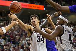 Texas A&M center Tyler Davis (34) reaches for a rebound against LSU during the second half of an NCAA college basketball game Saturday, Jan. 6, 2018, in College Station, Texas. (AP Photo/Sam Craft)