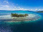 Aerial photograph of Motu Miri Miri, Raiatea, French Polynesia. Tahaa island is in the background.