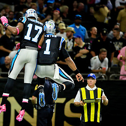 Oct 16, 2016; New Orleans, LA, USA; Carolina Panthers quarterback Cam Newton (1) celebrates with wide receiver Devin Funchess (17) after a touchdown against the New Orleans Saints during the second quarter of a game at the Mercedes-Benz Superdome. Mandatory Credit: Derick E. Hingle-USA TODAY Sports