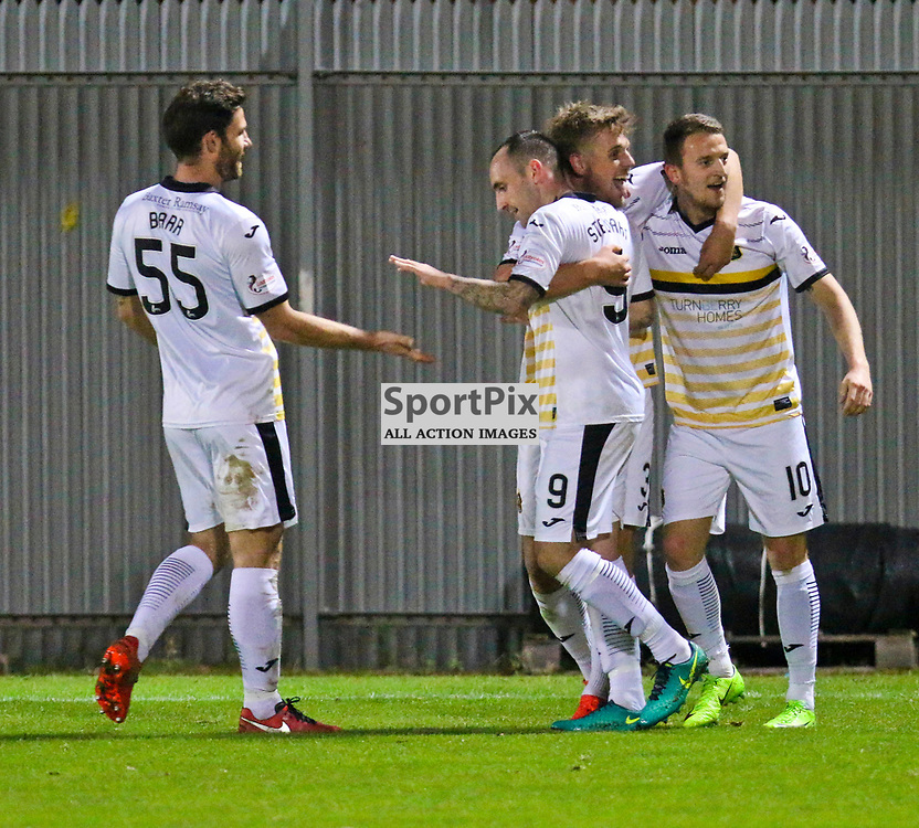 Players celebrate with Mark Stewart after scoring Sons second goal during the Dumbarton v Stranraer Irn Bru Cup round three 06 October 2017<br /> <br /> <br /> <br /> <br /> <br /> (c) Andy Scott   SportPix.org.uk