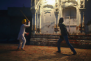 Sikh young men practicing Gatka, the sikh martial art.
