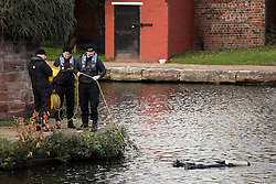 © Licensed to London News Pictures . 16/11/2015 . Liverpool , UK . Underwater search team at the Leeds-Liverpool Canal in the Eldonian Village area of Liverpool where a 16 year old boy was shot dead last night (15th November 2015 ) . Photo credit: Joel Goodman/LNP