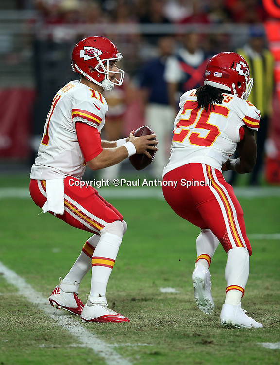 Kansas City Chiefs quarterback Alex Smith (11) gets a block from Kansas City Chiefs running back Jamaal Charles (25) as he drops back to pass during the 2015 NFL preseason football game against the Arizona Cardinals on Saturday, Aug. 15, 2015 in Glendale, Ariz. The Chiefs won the game 34-19. (©Paul Anthony Spinelli)