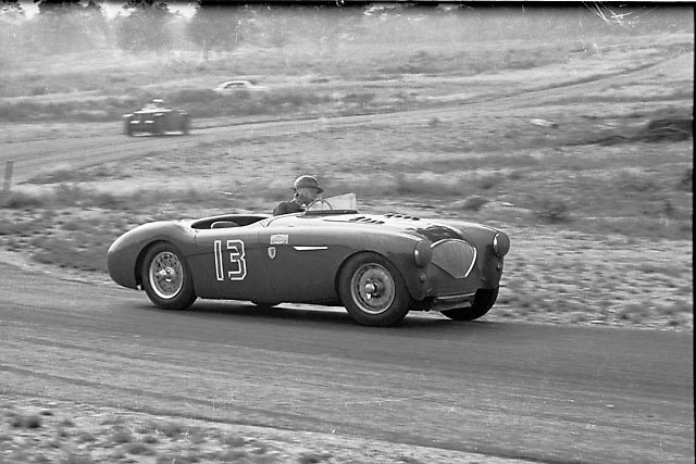 Believed to be actor Jackie Cooper driving his Austin Healey in a race at Thompson, CT, circa 1954