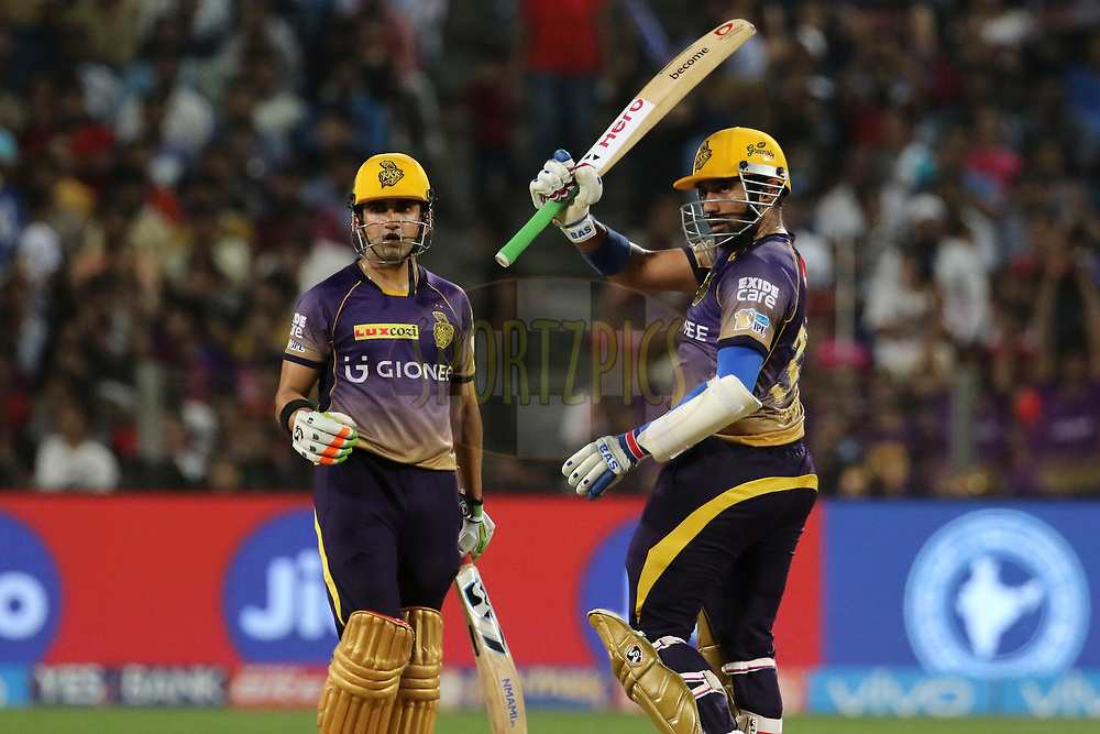 Robin Uthappa of the Kolkata Knight Riders raises his bat after scoring a fifty during match 30 of the Vivo 2017 Indian Premier League between the Rising Pune Supergiants and the Kolkata Knight Riders  held at the MCA Pune International Cricket Stadium in Pune, India on the 26th April 2017<br /> <br /> Photo by Vipin Pawar- IPL - Sportzpics