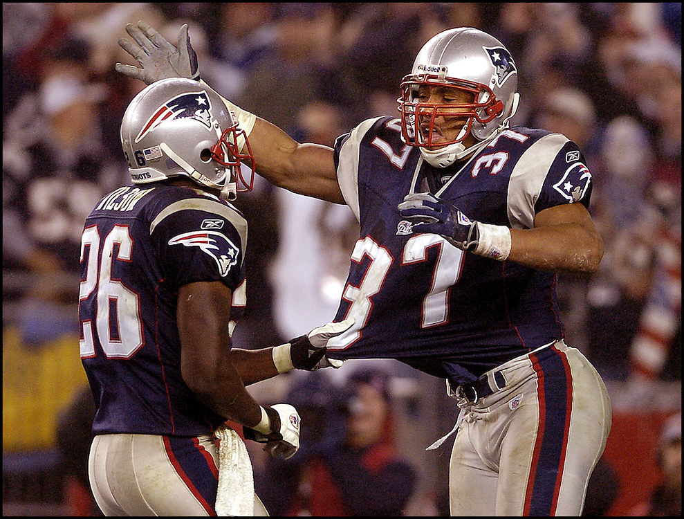 (10/24/04 Foxboro, MA) New England Patriots vs the NY Jets.Rodney Harrison and Eugene Wilson celebrate after Harrison breaks up a key 4th down pass to insure a Patriots victory.  (102404patsmjs-staff photo by Michael Seamans. Saved in photo Monday/cd)