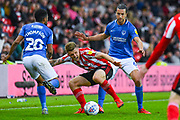 Christian Burgess of Portsmouth (6) fouls. Max Power of Sunderland (27) during the EFL Sky Bet League 1 first leg Play Off match between Sunderland and Portsmouth at the Stadium Of Light, Sunderland, England on 11 May 2019.