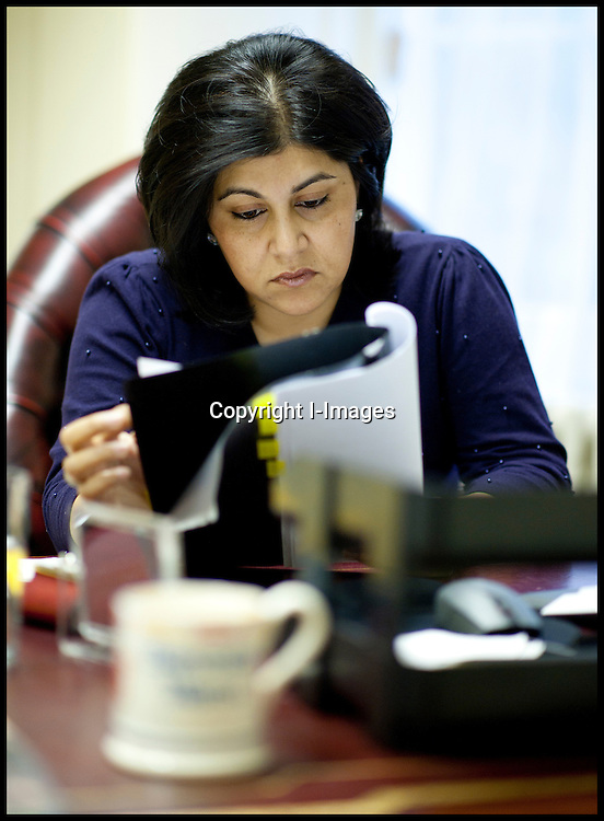Sayeeda Warsi Minister without portfolio being briefed before meeting  the American Ambassador Louis Susman in her office in the Cabinet office, Photo By Andrew ParsonsSayeeda Warsi Minister without portfolio working in her office in the Cabinet office, Photo By Andrew Parsons