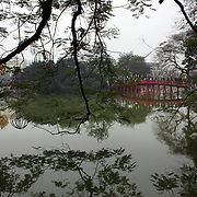 The wooden red-painted Huc Bridge, also know as the Morning Sunlight Bridge and The Red Bridge which connects Jade Island to the shore of Hoan Kiem Lake, in the centre of Hanoi, Vietnam, 17th March 2012. Photo Tim Clayton