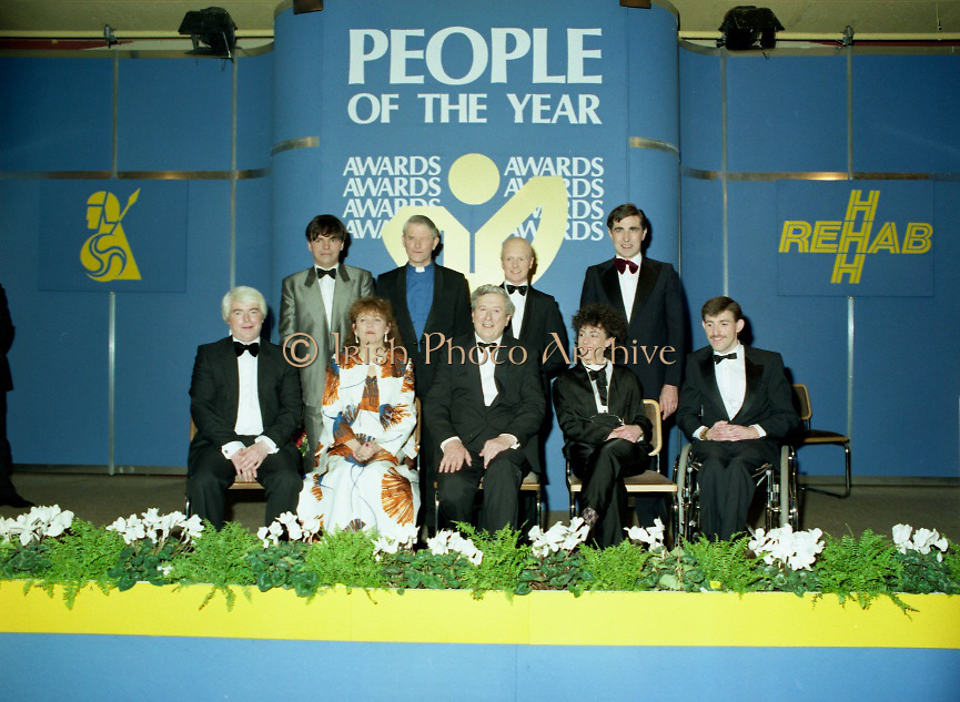 People Of The Year Awards..1986..24.11.1986..11.24.1986..24th November 1986..The 1986 People of the Year Awards,sponsored by New Ireland Assurance and the Rehabilitation Institute,were presented by An Taoiseach,Dr Garrett Fitzgerald at the Burlington Hotel,Dublin..Picture of the award winners with An Taoiseach,Dr Garret Fitzgerald,(centre-front row).(front row)L-R. Mr William Houlihan,Dr Susan McKenna-Lawlor,Ms Garry Hynes and Mr Cathal McDonagh..(back row)L-R. Mr Neil Jordan,Rev Cecil Kerr,Mr Jonjo O'Neill and Mr Denis Brosnan
