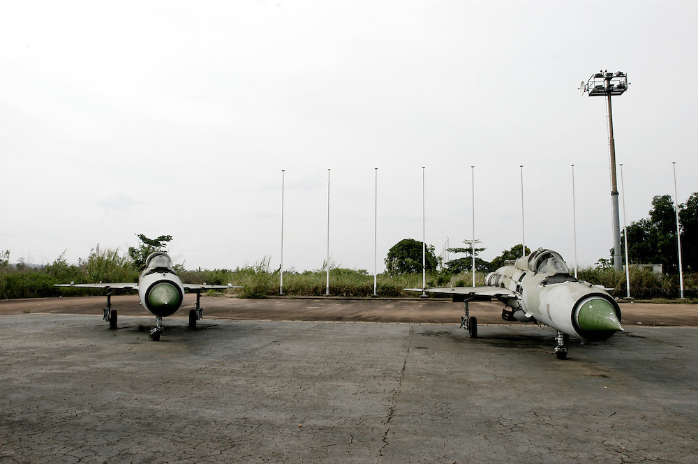 Decaying fighter jets on the tarmac of the Moanda Airport which was built by Mobutu Sese Seko to receive the Concord in his native village in Equateur province and was Africa's largest airport. .Gbadolite, DR Congo. 16/03/2009.Photo © J.B. Russell
