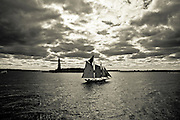A schooner sails by the Liberty Statue, New york.