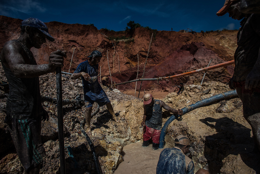 "LAS CLARITAS, VENEZUELA - JULY 20, 2016:  Thousands of Venezuelans are flocking to illegal gold mines, like this one, called ""Cuatro Muertos"" (""Four Dead"" because four miners have died here since the mine was dug) in hopes of surviving the current economic crisis by earning in gold instead of the national currency, whose value steadily falls due to the world's highest inflation.  From this remote part of the jungle the migrant miners have become the vectors of a new epidemic of malaria, because the hot, swampy conditions of the mines make for an ideal breeding ground for mosquitos. Miners spread the disease as they return home with earnings or pay visits to family members. Dozens of miners that work in this mine said that they have contracted malaria multiple times, some even dozens of times. The economic crisis has also left the government without the financial resources to control the disease - they are unable to fumigate homes, provide medicines to everyone that is sick, or even to test all patients with symptoms of malaria in many places. PHOTO: Meridith Kohut for The New York Times"