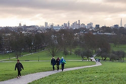 Primrose Hill, London, February 15th 2015. people walk on a chilly early morning on Primrose Hill, overlooking London&rsquo;s skyline.<br /> ///FOR LICENCING CONTACT: paul@pauldaveycreative.co.uk TEL:+44 (0) 7966 016 296 or +44 (0) 20 8969 6875. &copy;2015 Paul R Davey. All rights reserved.