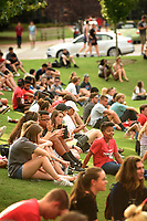 Students sit along the edge of Harris Field for the WKNC Concert on the Lawn during Wolfpack Welcome Week.