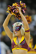 March 8, 2011; Cleveland, OH, USA; A Cleveland Cavaliers cheerleader sports a Marti Gras mask during the fourth quarter against the Golden State Warriors at Quicken Loans Arena. The Warriors beat the Cavaliers 95-85. Mandatory Credit: Jason Miller-US PRESSWIRE