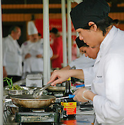 Tim Bagnas (right), Warren High School/NISD, focuses on creating his entree at the City South Festival Culinary Competition, held at Brooks City-Base, Texas on March 25, 2007. High school students from some of San Antonio's high school culinary programs competed St. Philip's College Culinary School scholarships.  Judging was performed by chefs from the San Antonio Chapter of the Texas Chefs Association.  (Photos/Lance Cheung) ..PHOTO COPYRIGHT 2007 LANCE CHEUNG.This photograph is NOT within the public domain..This photograph is not to be downloaded, stored, manipulated, printed or distributed with out the written permission from the photographer. .This photograph is protected under domestic and international laws.