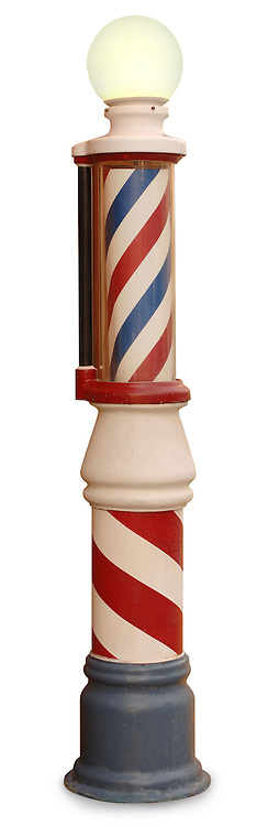 Free standing vintage barber pole on a white background with clipping path