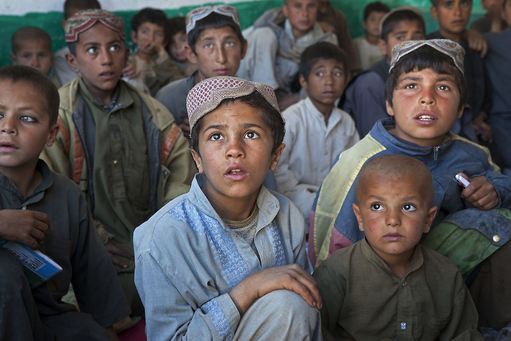 Young Afghan boys at a school close to a British army checkpoint in Nad Ali, Hemand Province, Afghanistan on the 10th of March 2011.