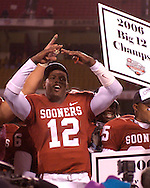 University of Oklahoma quarterback Paul Thompson (12) celebrates after the Sooners beat Nebraska 21-7 in the Big 12 Championship at Arrowhead Stadium in Kansas City, Missouri, December 2, 2006.<br />