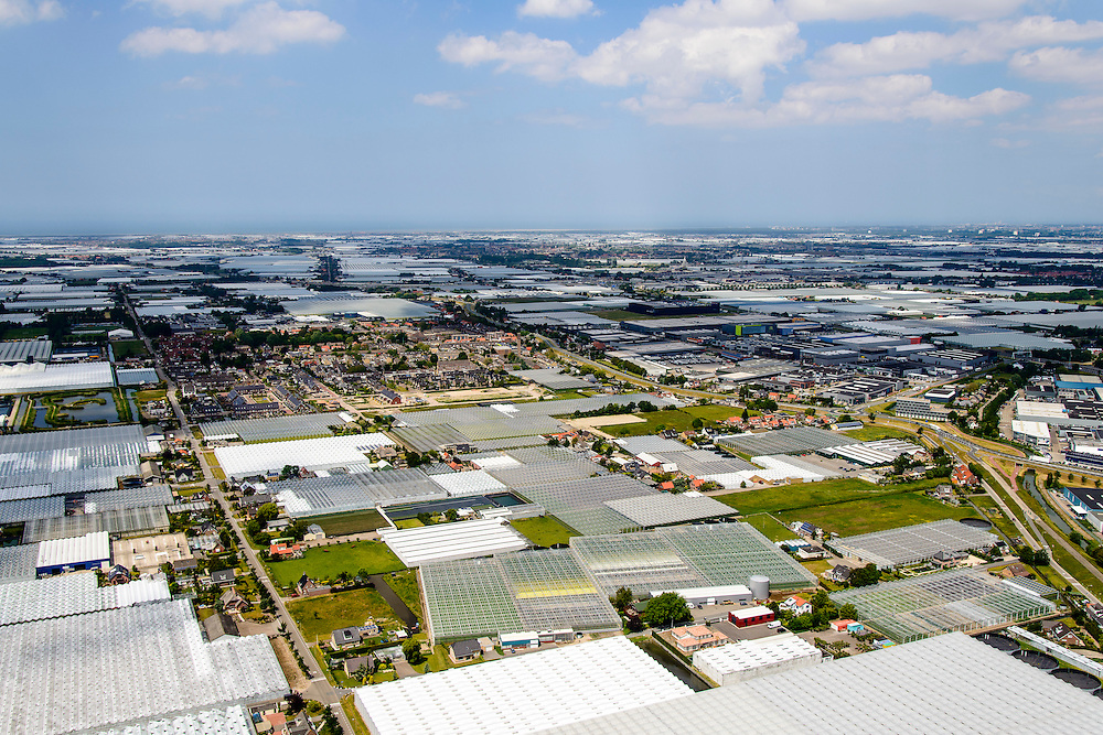 Nederland, Zuid-Holland, Rotterdam, 10-06-2015; Glazen stad, Kassengebied Westland, omgeving dorp Maasdijk<br /> Greenhouses area in the West of the Netherlands, the heart of the production of vegetables and fruit for export. Between The Hague and Rotterdam<br /> <br /> luchtfoto (toeslag op standard tarieven);<br /> aerial photo (additional fee required);<br /> copyright foto/photo Siebe Swart