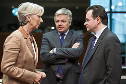 Christine Lagarde, France's finance minister, left, speaks with George Papaconstantinou, Greece's finance minister, right, and Didier Reynders, Belgium's finance minister, center, during the emergency meeting of European Union finance ministers in Brussels, Belgium, on Sunday, May 9, 2010.  European Union finance ministers meet today to hammer out the details of an emergency fund to prevent a sovereign debt crisis from shattering confidence in the 11-year-old euro. (Photo © Jock Fistick)