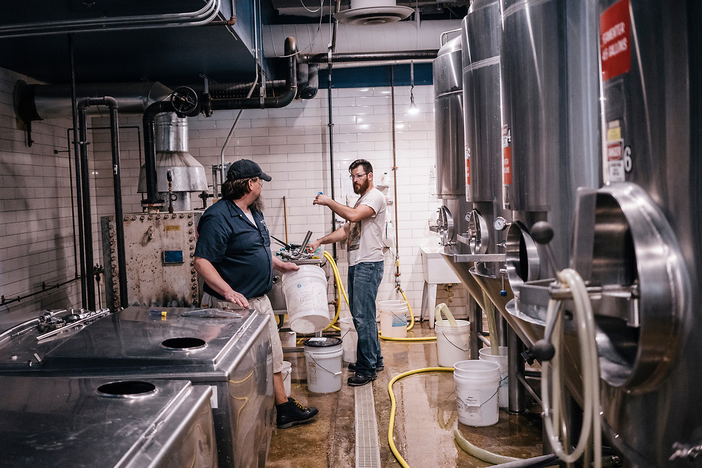 Erik Faden, a brewer at Denizens Brewing Co., talks with Chris Surrusco, left, as Faden cleans and places parts on a <br /> fermentation tank at their facility in Silver Spring, Md. on April 5, 2017. Recent back-to-back vetoes of $15 minimum-wage bills in the liberal Maryland bastions of Baltimore and Montgomery County could signal a limit to such efforts. CREDIT: Greg Kahn / GRAIN for the Wall Street Journal MINWAGE