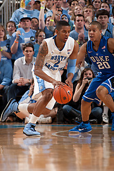 CHAPEL HILL, NC - MARCH 05: Leslie McDonald #2 of the North Carolina Tar Heels dribbles the ball around Andre Dawkins #20 of the Duke Blue Devils on March 05, 2011 at the Dean E. Smith Center in Chapel Hill, North Carolina. North Carolina won 67-81. (Photo by Peyton Williams/UNC/Getty Images) *** Local Caption *** Leslie McDonald;Andre Dawkins