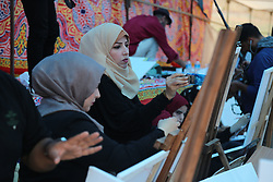 May 5, 2018 - Gaza, Palestinian Territories, Palestine - Palestinian artists paint artworks during tents protest where Palestinians demanding the right to return to their homeland, at the Israel-Gaza border, in Jabalia in the northern of Gaza Strip on May 5, 2018. (Credit Image: © Majdi Fathi/NurPhoto via ZUMA Press)