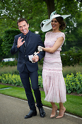 © London News Pictures. 18/06/2013. Ascot, UK.  Bruno Tonioli (left) and Danielle Lineker, wife of former footballer Garry Lineker, attending day one of Royal Ascot at Ascot racecourse in Berkshire, on June 18, 2013.  The 5 day showcase event,  which is one of the highlights of the racing calendar, has been held at the famous Berkshire course since 1711 and tradition is a hallmark of the meeting. Top hats and tails remain compulsory in parts of the course. Photo credit should read: Ben Cawthra/LNP