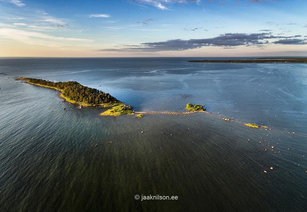 Käsmu Kuradisaar in Lahemaa, Estonia. Aerial view. Small island in Baltic sea covered trees.