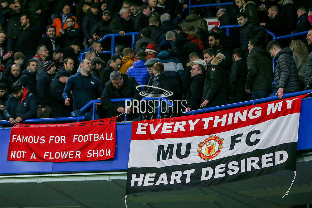 Manchester United fans with flags, Famous for Football Not a Flower Show during the The FA Cup 5th round match between Chelsea and Manchester United at Stamford Bridge, London, England on 18 February 2019.