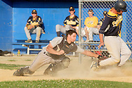 Middletown, NY - A catcher tags a baserunner at home plate during a Collegiate League baseball game at Watts Park on July 2, 2008.