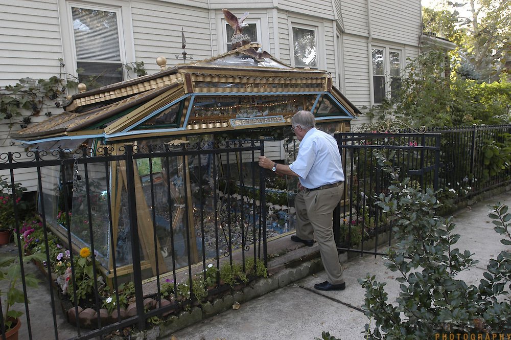 DATE: 9/19/05.DESK: CITY.SLUG: CRETE.ASSIGN ID: 10008375A..George Kortsolakis, 77, has created a miniature replica of the Mediterranean island of Crete, his homeland, in a structure he built outside of his family's home in Bay Ridge, Brooklyn. The lights in the background are from his replica of Crete. ..photo by Angela Jimenez for The New York Times.photographer contact 917-586-0916 ..
