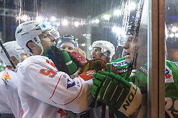 Roughing between Luka Tosic of Jesenice and Anze Ropret of Olimpija during ice hockey match between HDD Telemach Olimpija and HDD SIJ Acroni Jesenice at Winter Classic of HDD Telemach Olimpija called Pivovarna Union Ice Fest 2014, on December 18, 2014 on Republic Square, Ljubljana, Slovenia. (Photo By Matic Klansek Velej / Sportida.com)