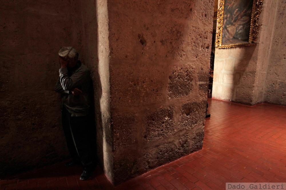 A Peruvian man prays at the Cia de Jesus church in Arequipa, Peru, Saturday, Jan. 22, 2011.(Photo Dado Galdieri)